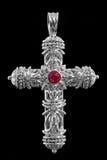 Cross pendant  with diamonds and rubies Stock Photos