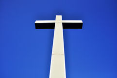 Cross in perspective on blue sky Royalty Free Stock Photo