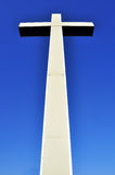 Cross in perspective on blue sky Royalty Free Stock Image