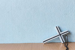 Cross placed at the wall Royalty Free Stock Photography