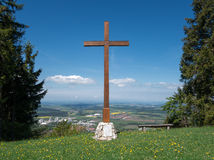 Cross on the Plettenberg in the Swabian Alps. Cross on the Plettenberg, Swabian Alps, Germany: big mountain cross made of oak wood between two spruces royalty free stock photos