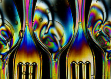 Cross polarization. Abstract colorful light effectsn with spoon and fork Stock Photography