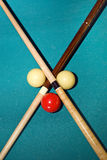 Cross with pool sticks Royalty Free Stock Photos