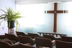 Cross in a prayer room Stock Photos