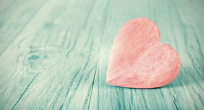 Cross processed heart on wooden background. Royalty Free Stock Image