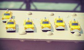 Cross processed instagram photo of taxi toys on Brooklyn Bridge. Royalty Free Stock Photo