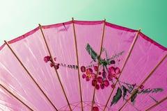Cross-processed pink umbrella Stock Image