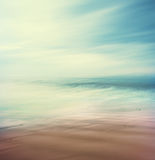 Cross-Processed Sea and Sand. An abstract, time-exposure seascape with panning movement. Image displays a retro, vintage look with cross-processed colors royalty free stock photography