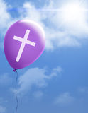 Cross on purple balloon Stock Photos