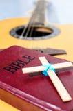 The Cross put on Bible. The Cross put on Bible and Bible put on guitar Royalty Free Stock Photos