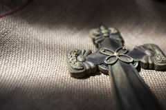 Cross put on sackcloth Royalty Free Stock Images