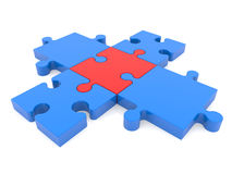 Cross of puzzle pieces in blue and red colors Royalty Free Stock Photography
