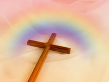 Cross with rainbow. Christian cross on veil with colorful rainbow around it royalty free stock photography