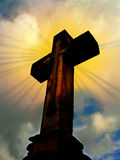 Cross and rays of light. Old Christian stony cross with sky and rays of light royalty free stock photography