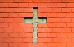 Cross in red brick wall Royalty Free Stock Photo