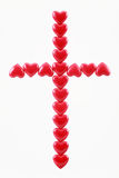 Cross from red hearts. On a white background Stock Image