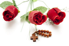 Cross with red roses Royalty Free Stock Photography
