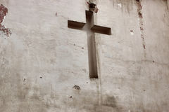 Cross religion white background. Worn and damaged by rain and weather cross religion on a white background stock images