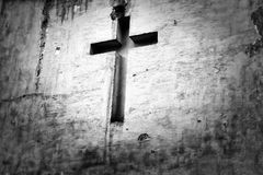 Cross religion white background. Worn and damaged by rain and weather cross religion on a white background stock photography
