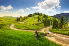 Cross road on hillside meadow in mountain Royalty Free Stock Photos