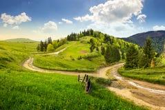 Cross road on hillside meadow in mountain Royalty Free Stock Photos
