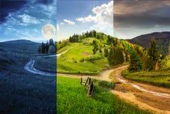Cross road on hillside meadow in mountain Stock Photo