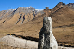 Cross, road and mountains Royalty Free Stock Image