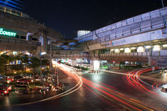 Cross road. Night time. Blurred lights at the City road and BTS Skytrain Track in Bangkok, Thailand Stock Photography