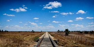 Cross roads in the desert. A crossing of rail and road that go on forever somewhere in the middle of Cuba royalty free stock images