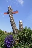 Cross, roadside calvary of wood, trunk. On a meadow Royalty Free Stock Image