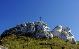 Cross on a rock. Against the sky royalty free stock photography