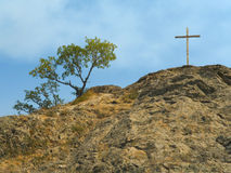 Cross on rock Royalty Free Stock Photography