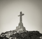 Cross on a rock hill, Tinos, Greece. Royalty Free Stock Photos