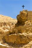 Cross on the rock, long way to go, Wadi Qelt, Judean Desert.  Royalty Free Stock Image