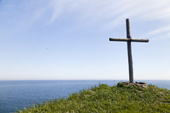 Cross on the rock Stock Photography