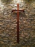 Cross on Rock wall Stock Image