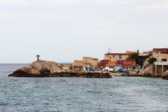 Cross upon the rocks near little port, Marseille, France Stock Photo
