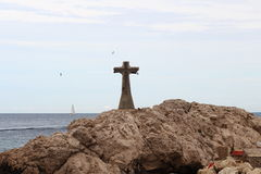 Cross upon the rocks near Marseille, France Stock Images