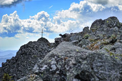 Cross on the rocky top of mountain Royalty Free Stock Photography