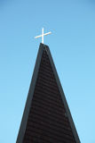 Cross on a roof Stock Images