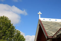 Cross on the roof of the Busknes church Stock Photo