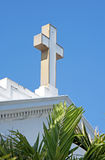 Cross on the roof top of an old white church Royalty Free Stock Image