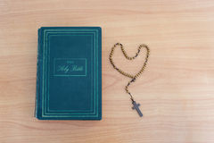 Cross of rosary beads and bible Stock Photo