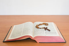 Cross of rosary beads white bible. Royalty Free Stock Images