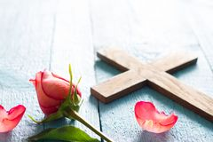 Cross and rose abstract easter religion concept background. Closeup Stock Image