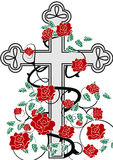 Cross with roses. Grey crucifix with red roses Royalty Free Stock Photos