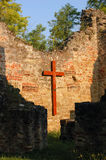 Cross, Ruin, Church, Religion, Catholicism. Wooden cross on the brick wall of a ruined church in Radpuszta, Hungary royalty free stock photography