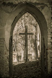Cross in the ruins of the old church.  Strange place. Stock Photo