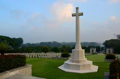Cross of Sacrifice and tombstones at World War Two soldiers Kranji War Cemetery Singapore royalty free stock images