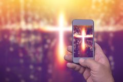 Cross in screen mobile phone, spirituality religion. Online concept Royalty Free Stock Photo